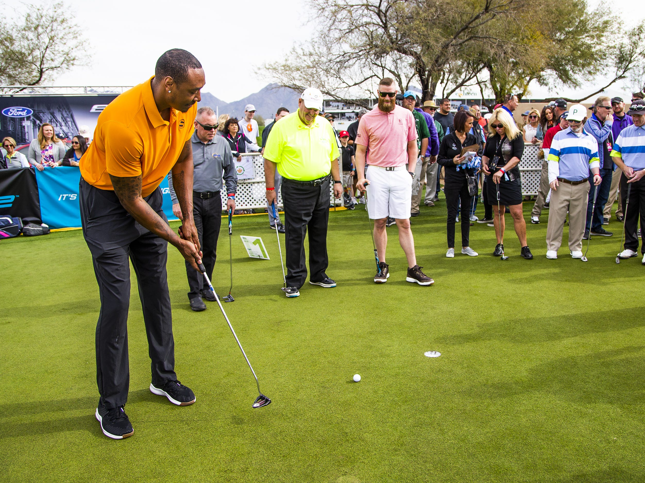 Phoenix Suns community ambassador Steven Hunter, left, putts during the San Tan Ford Special Olympics Open at the Waste Management Phoenix Open at the TPC Scottsdale, Tuesday, January 29, 2019.