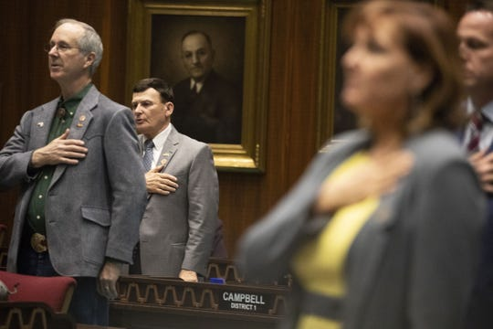 Rep. David Stringer stands on the house floor with other members on Jan. 28, 2019. The Arizona House of Representatives refused to vote on a motion to expel Stringer over revelations that he was charged with sex offenses in 1983.