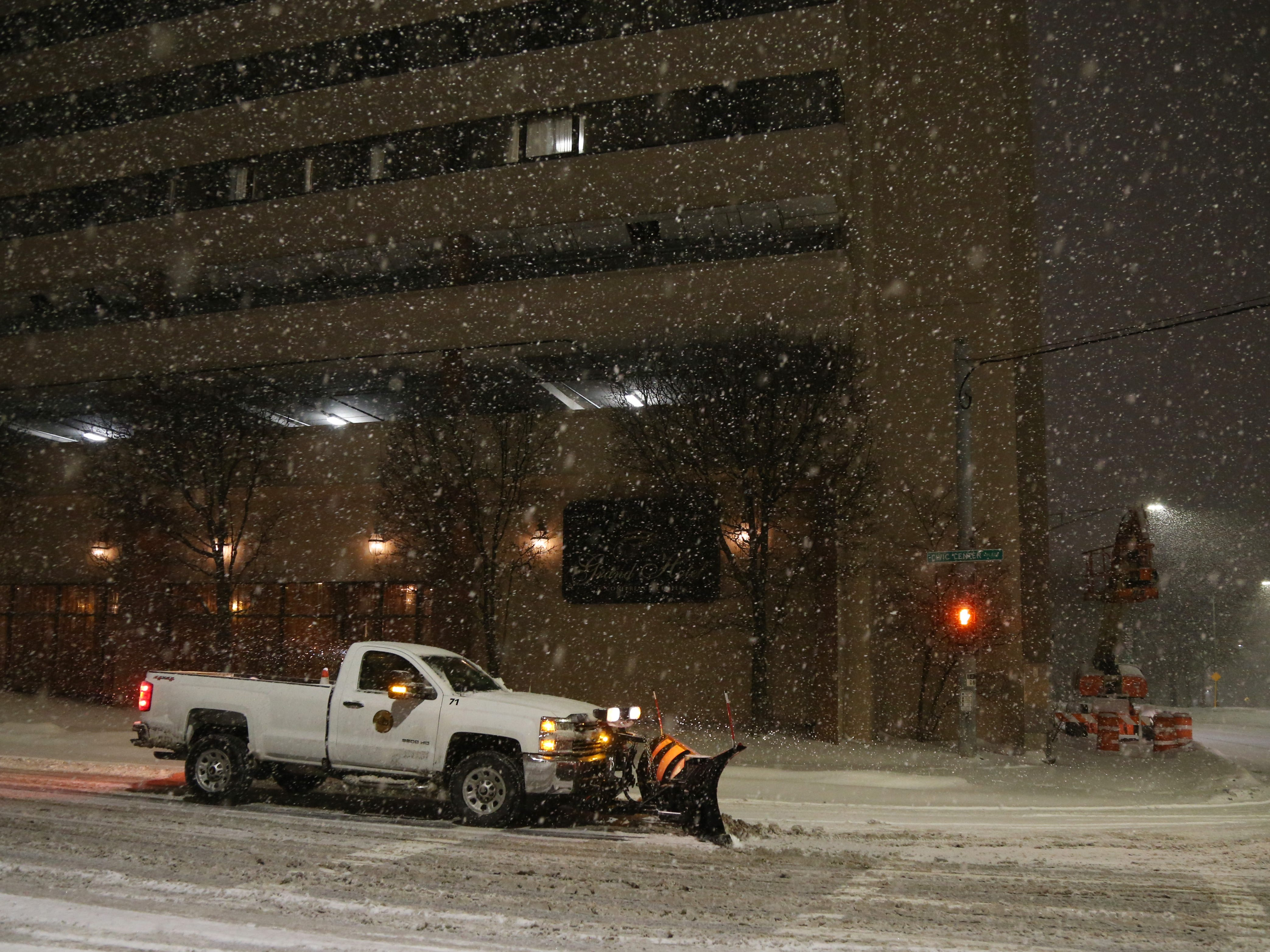 A City of Poughkeepsie maintenance truck with a plow stopped at Civic Center Plaza and the westbound arterial in the City of Poughkeepsie on January 29, 2019.