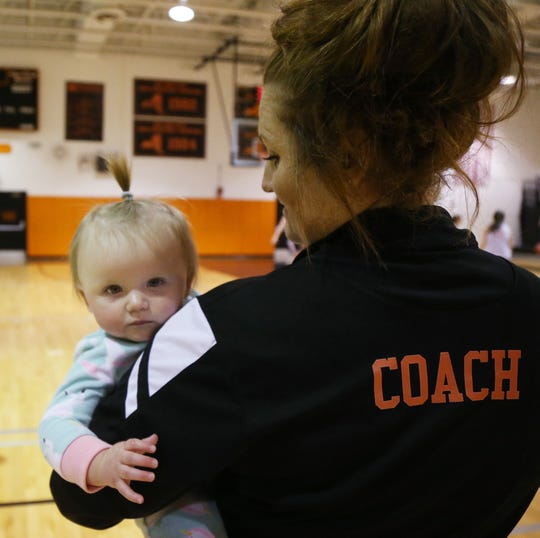 Marlboro basketball coach Marion Casey with her daughter Remi during practice at Marlboro High School on January 22, 2019.