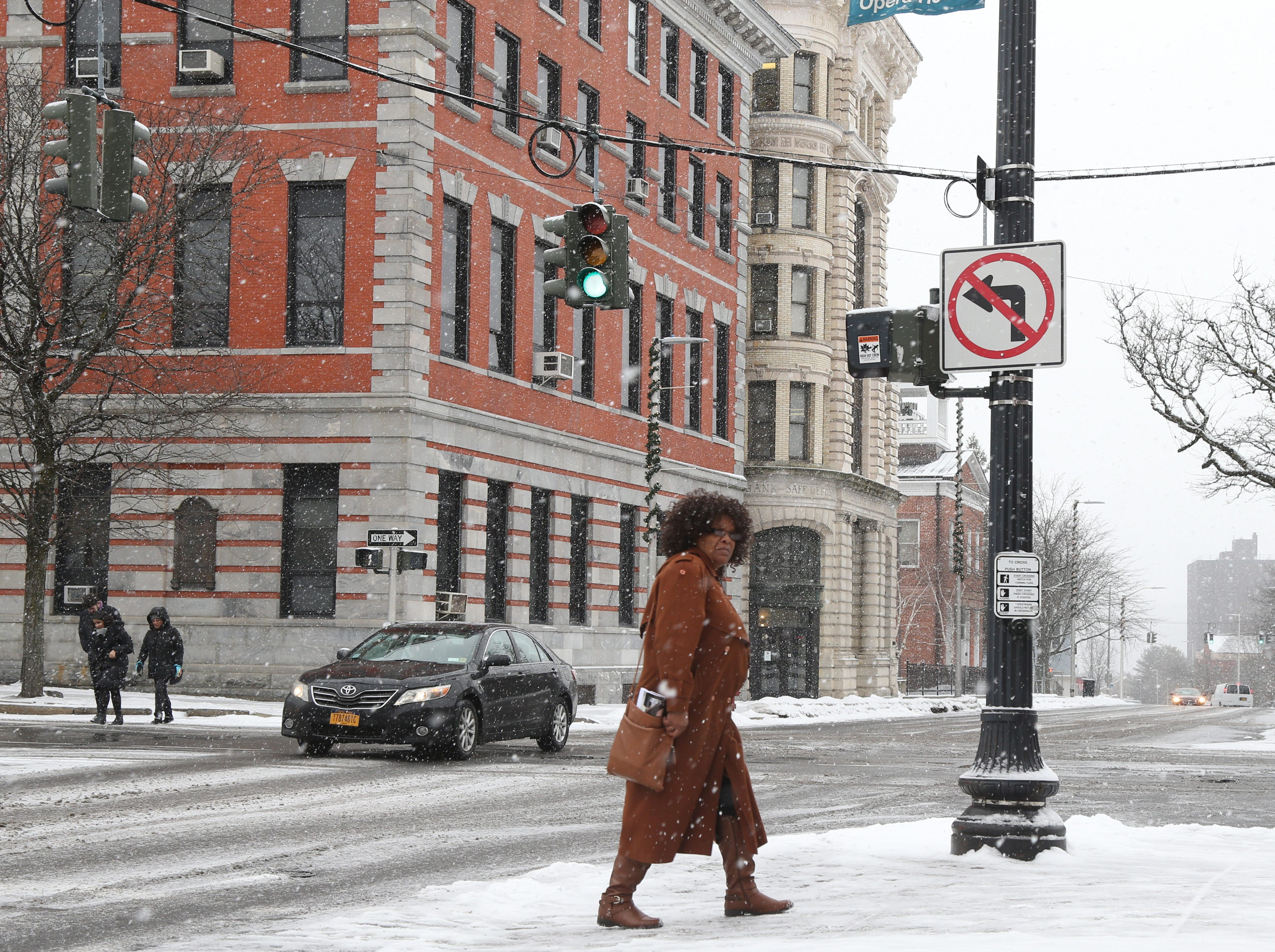 Lynn Holder of Wappingers Falls makes her way back to her car on Market Street in the City of Poughkeepsie on January 29, 2019.