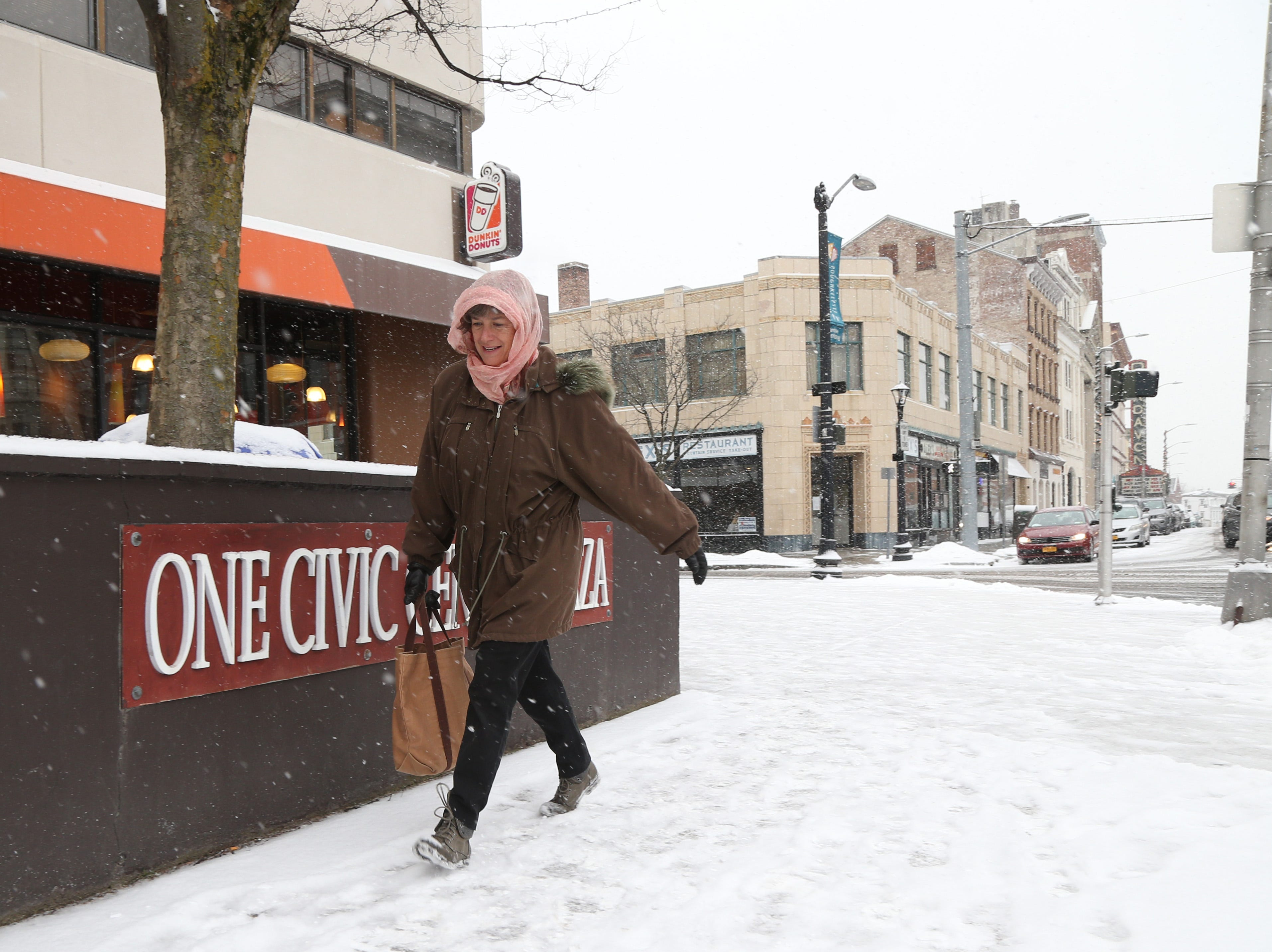 Gretchen Werner of Red Hook carefully navigates the snowy sidewalks of Market Street in the City of Poughkeepsie on January 29, 2019.