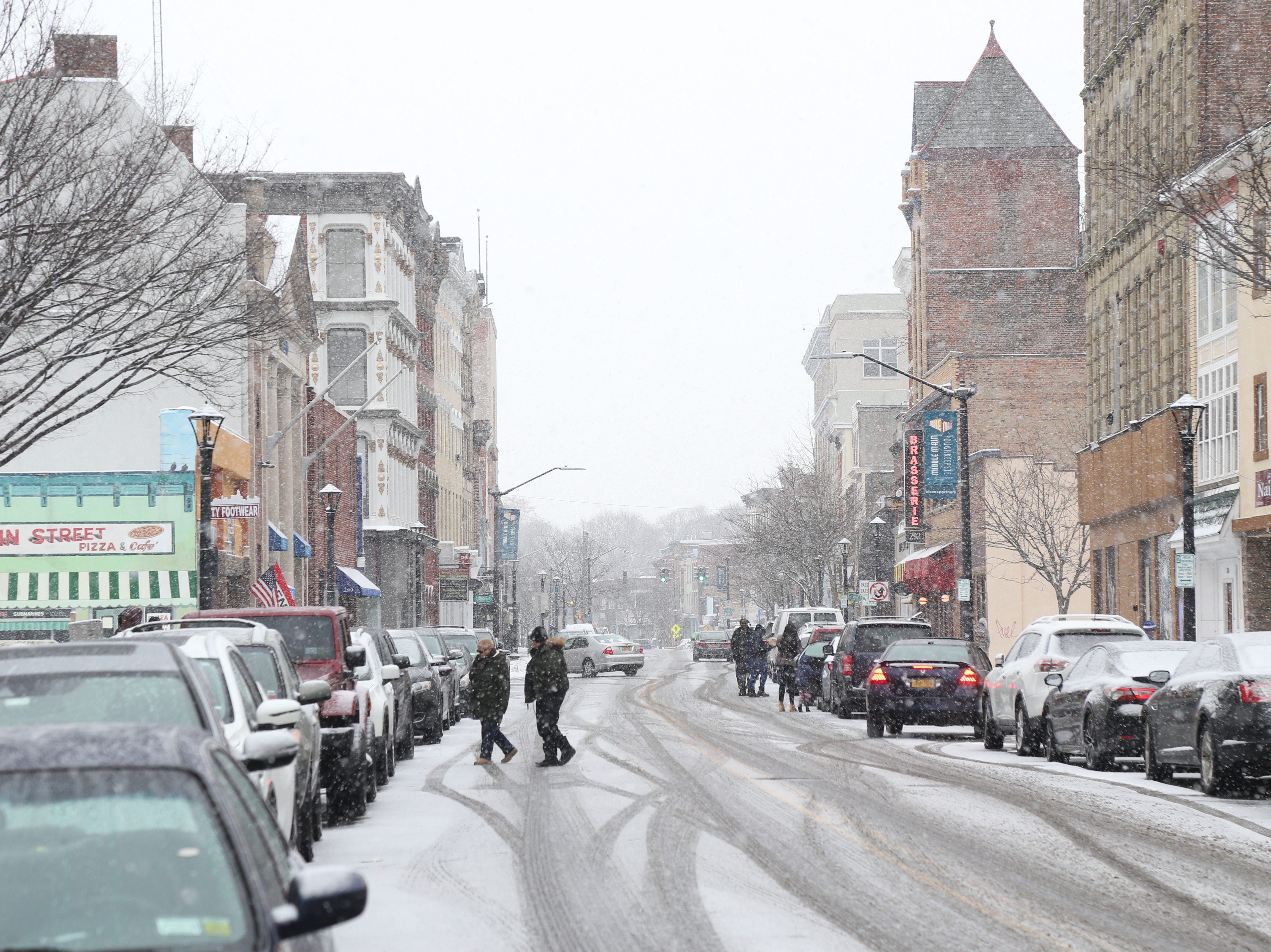 Snow begins to accumulate during the lunch rush on Main Street in the City of Poughkeepsie on January 29, 2019.