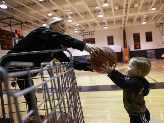 Marlboro basketball assistant coach Katelyn Davis hands her son Ty a ball during practice at Marlboro High School on January 22, 2019.