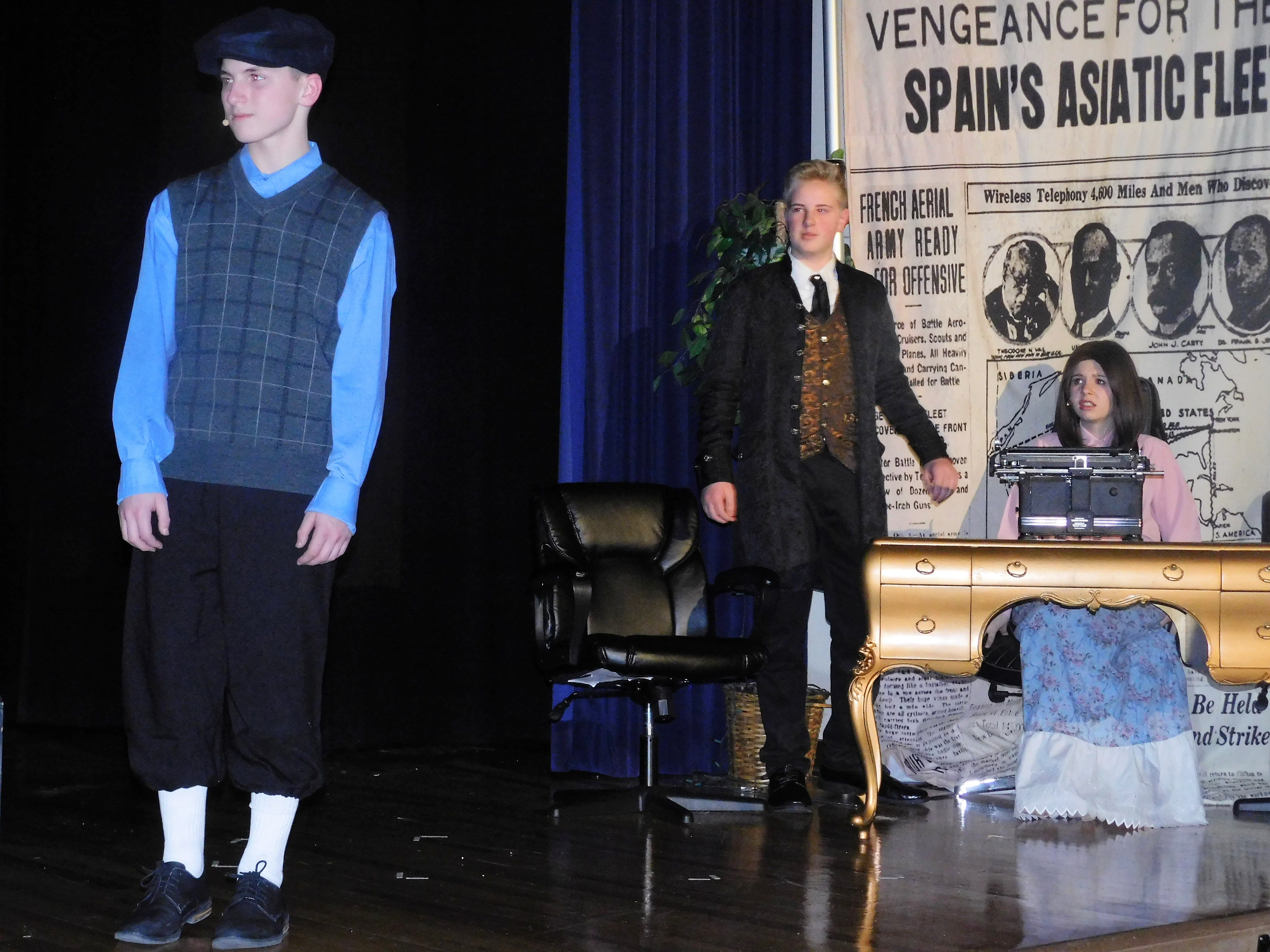 """From left, Nate Phillips (as Jack Kelly), Brodie Meyers (as Joseph Pulitzer) and Madi Ross (as Katherine Plumber) rehearse a scene in """"Newsies"""" on Jan. 23, 2019. Chambersburg Area Middle School North Drama Club will put on the musical, which depicts the New York City Newboys Strike of 1899, at 7:30 p.m. Feb. 1 and 2 in the CAMS North auditorium. For tickets, $8 plus fees, go to showtix4u.com."""