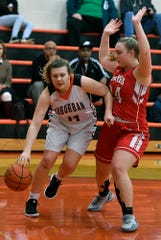 Alyssa Hucker of York Suburban is covered by Clare Neff of Pequea Valley, Monday, January 28, 2019.John A. Pavoncello photo