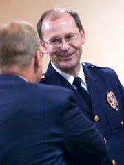York City Police Capt. Dave Arnold is congratulated by York City Mayor John Brenner during a police promotion ceremony shortly before Arnold retired after 24 years with the department.  (John Pavoncello photo)