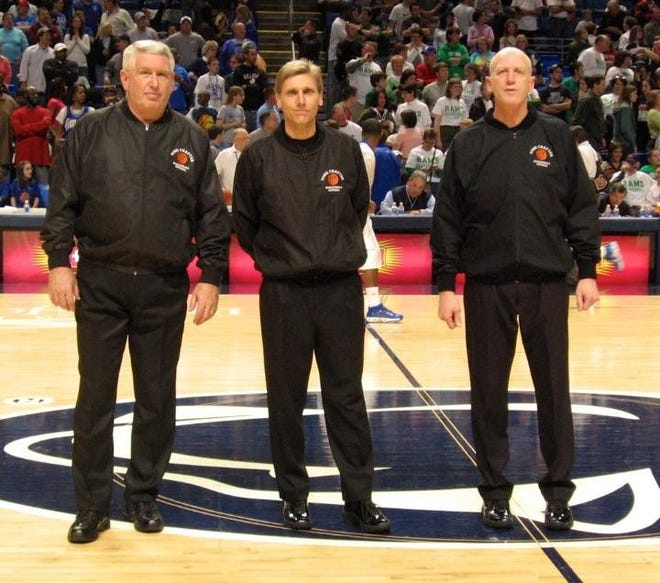 Dave Concino, right, is retiring at the end of this season after 44 years as a basketball official. He is shown here before working a state championship game at the Bryce Jordan Center. He is shown with fellow York-Adams officials John Eyster, middle, and Steve Keller.