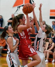 York Suburban's Brooke Sargen, left, and Lulu Mooney, right cover Caroline Hurst of Pequea Valley as she drives the paint, Monday, January 28, 2019.John A. Pavoncello photo