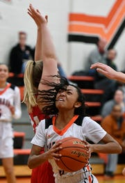 Kiyanna Downling of York Suburban drives past Clare Neff of Pequea Valley on her way to the hoop, Monday, January 28, 2019.