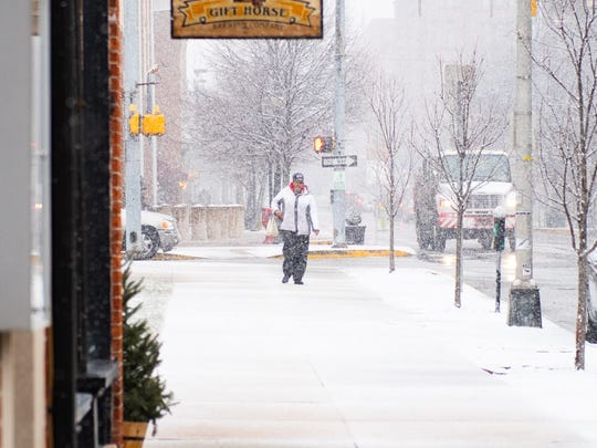 Snow accumulates on North George Street in York in January. Precipitation, including the potential for snow and ice, is in the forecast for this week.