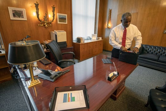 Michael Newsome, cabinet secretary for Governor Wolf, prepares for a weather briefing during a snowy day at his office at the state capital complex in Harrisburg Tuesday January 29, 2019.