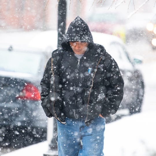 People in York were bundled up during Tuesday's snowfall, but the really cold temperatures start Wednesday, as a polar vortex plummets temperatures into the single digits.