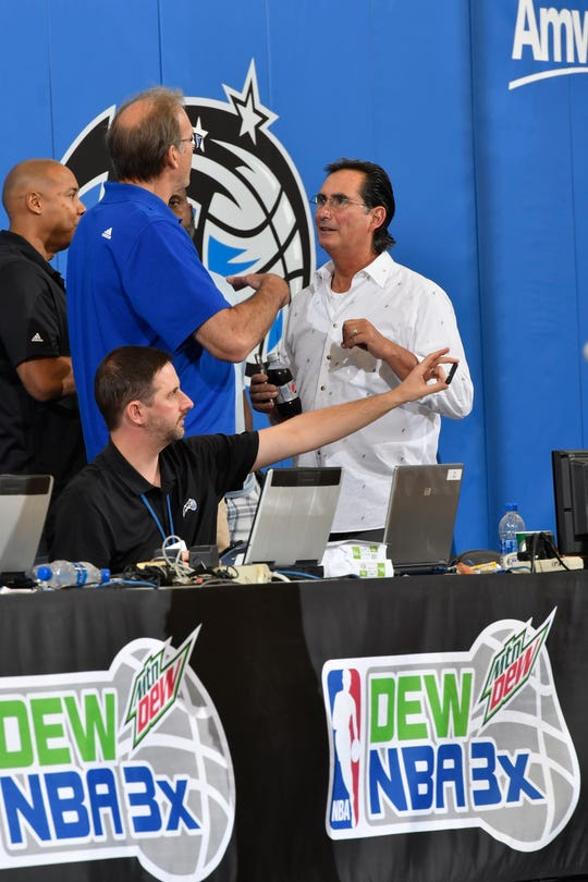 """John Gabriel, right, has been in the NBA ever since leaving Delone Catholic and then Kutztown University nearly 40 year ago. He hasn't let Parkinson's disease take away what he loves. Here, he works a Pro Summer League game in Orlando in 2017. """"I don't care how old you are when you have his experience and his intelligence and his creative thinking,"""" said Brian Hill, a two-time head coach of the Orlando Magic. """"One thing that always baffled me was why he was never a GM for another team after he left Orlando."""""""