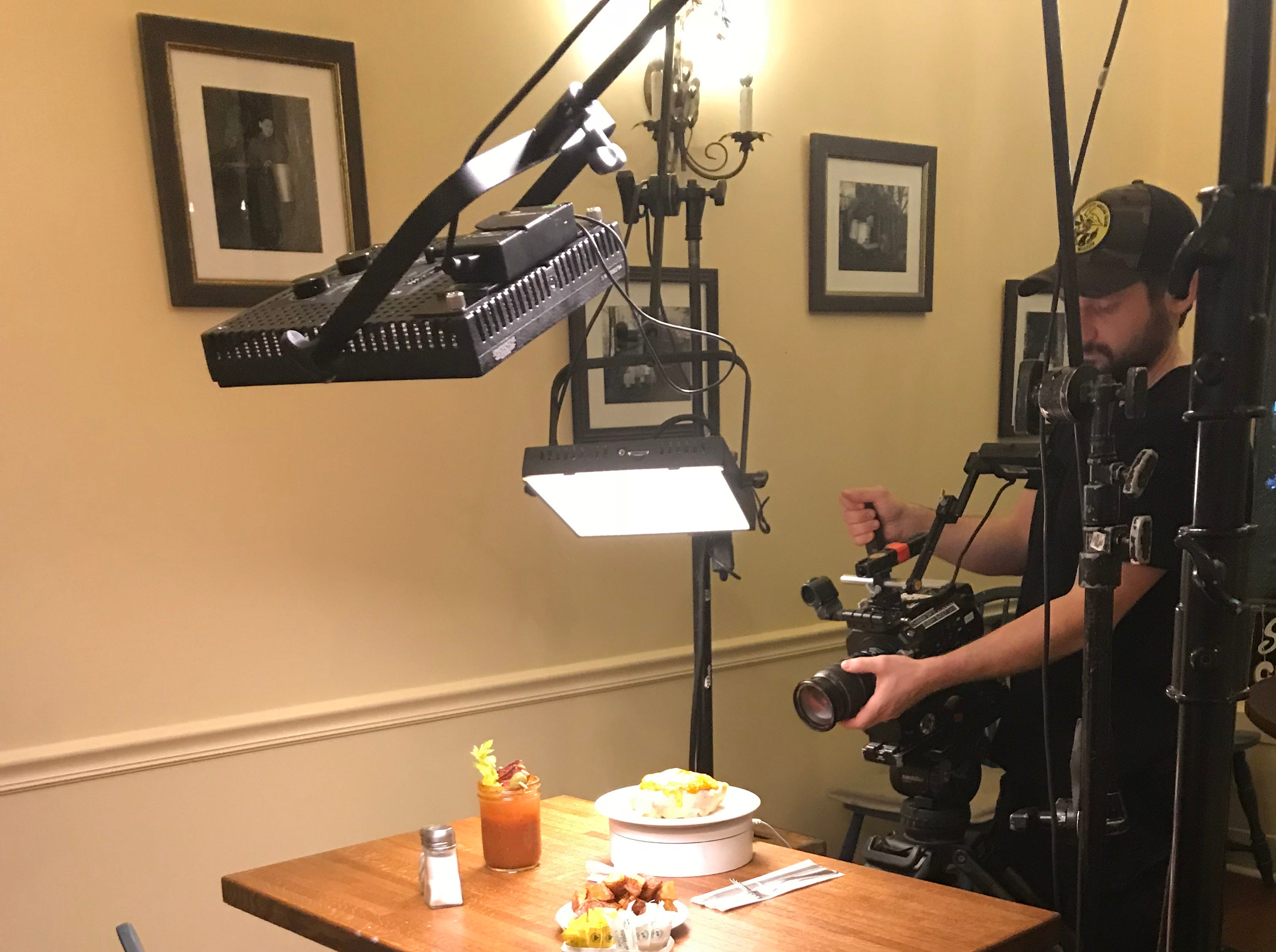 A camera operator for a Food Network show films a dish from Simply Crepes in September 2018.