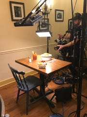 A camera operator films at the Canandaigua location of Simply Crepes in September 2018.