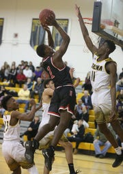 Hilton's Tah'Jae Hill drives hard to basket as Athena's Melvin Council, Jr. looks for the block.