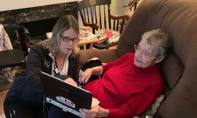 Rebecca Coleman visits patient Mildred Guardino of Lima, Livingston County.