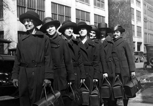 Visiting nurses, members of the Public Health Nursing Association, line up for duty in 1920.