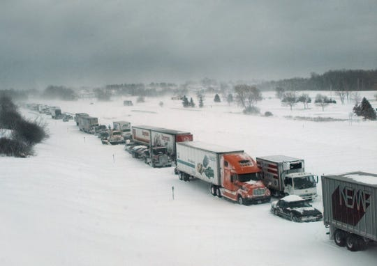 The Thruway is closed to traffic from Syracuse to Buffalo back during a 1999 snowstorm.