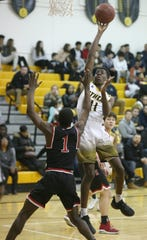 Athena's Melvin Council, Jr., right, drives to the basket over Hilton's TahJae Hill.