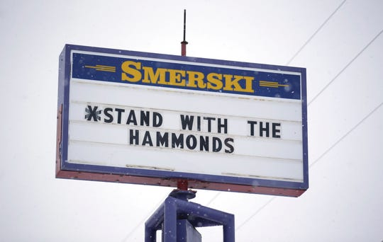 In this Jan. 5, 2016, file photo, a sign shows support for the Dwight and Steven Hammond in Burns, Ore. President Donald Trump on Tuesday, July 10, 2018, pardoned the two cattle ranchers convicted of arson in a case that case sparked the armed occupation of a national wildlife refuge in Oregon. Dwight and Steven Hammond were convicted in 2012 of intentionally and maliciously setting fires on public lands.