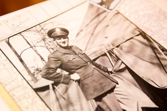 A photo of Art Gregg, one of the state's oldest World War II veterans, during his time in the military is shown in a book at his home in Silverton on Friday, Jan. 25, 2019. He is turning 100 years old on Feb. 16.