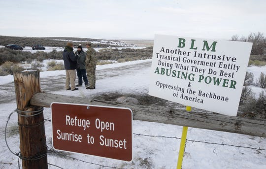 In this Jan. 4, 2016, file photo,, members of the group occupying the Malheur National Wildlife Refuge headquarters stand guard near Burns, Ore.