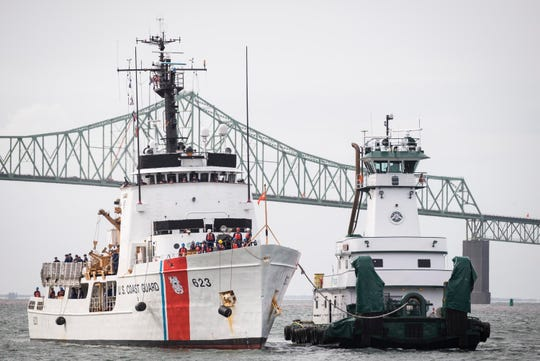 In this Sept. 14, 2015, file photo, the U.S. Coast Guard cutter Steadfast approaches Astoria, Ore., while being assisted by the PJ Brix tugboat. Anticipating possible additional federal government shutdowns, Oregon's Senate president has prepared a bill that will allow federal employees who are working but not being paid to receive unemployment benefits. The draft of the bill also would allow a state-funded program to pay unemployment benefits to active duty U.S. Coast Guard personnel stationed in Oregon who are legally compelled to provide regular service without compensation during a shutdown.