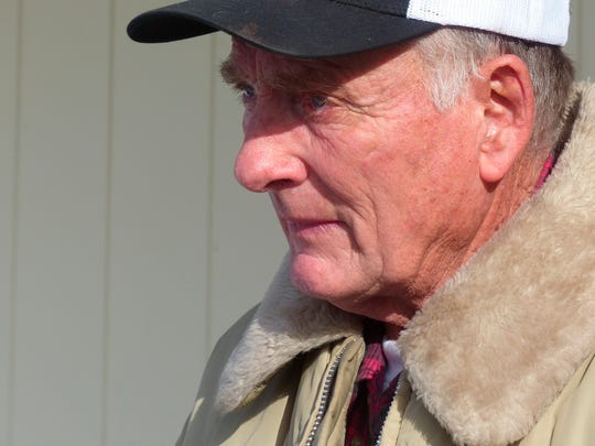 In this Jan. 2, 2016, file photo, rancher Dwight Hammond Jr. greets protesters outside his home in Burns, Ore. President Donald Trump has pardoned Dwight and Steven Hammond, two ranchers whose case sparked the armed occupation of a national wildlife refuge in Oregon. The Hammonds were convicted in 2012 of intentionally and maliciously setting fires on public lands.