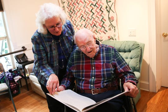 Art Gregg, one of the state's oldest World War II veterans, and his daughter Ann Snelling flip through a book she made him at his home in Silverton on Friday, Jan. 25, 2019. The book consists of photos, short stories and a timeline of his military service years.