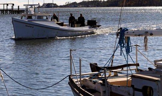 A crab boat wades into the dock along Gwynn's Island in November.
