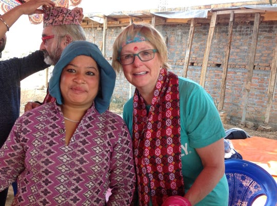 Marli Erickson helped build a home for this Nepalese woman and her family following the 2015 earthquake.