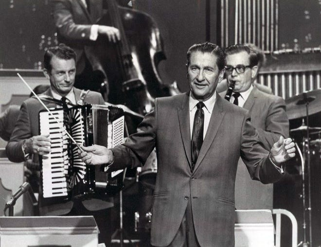 South Dakota native Myron Florens, left, plays his accordion on The Lawrence Welk Show in a 1969 show publicity photo.