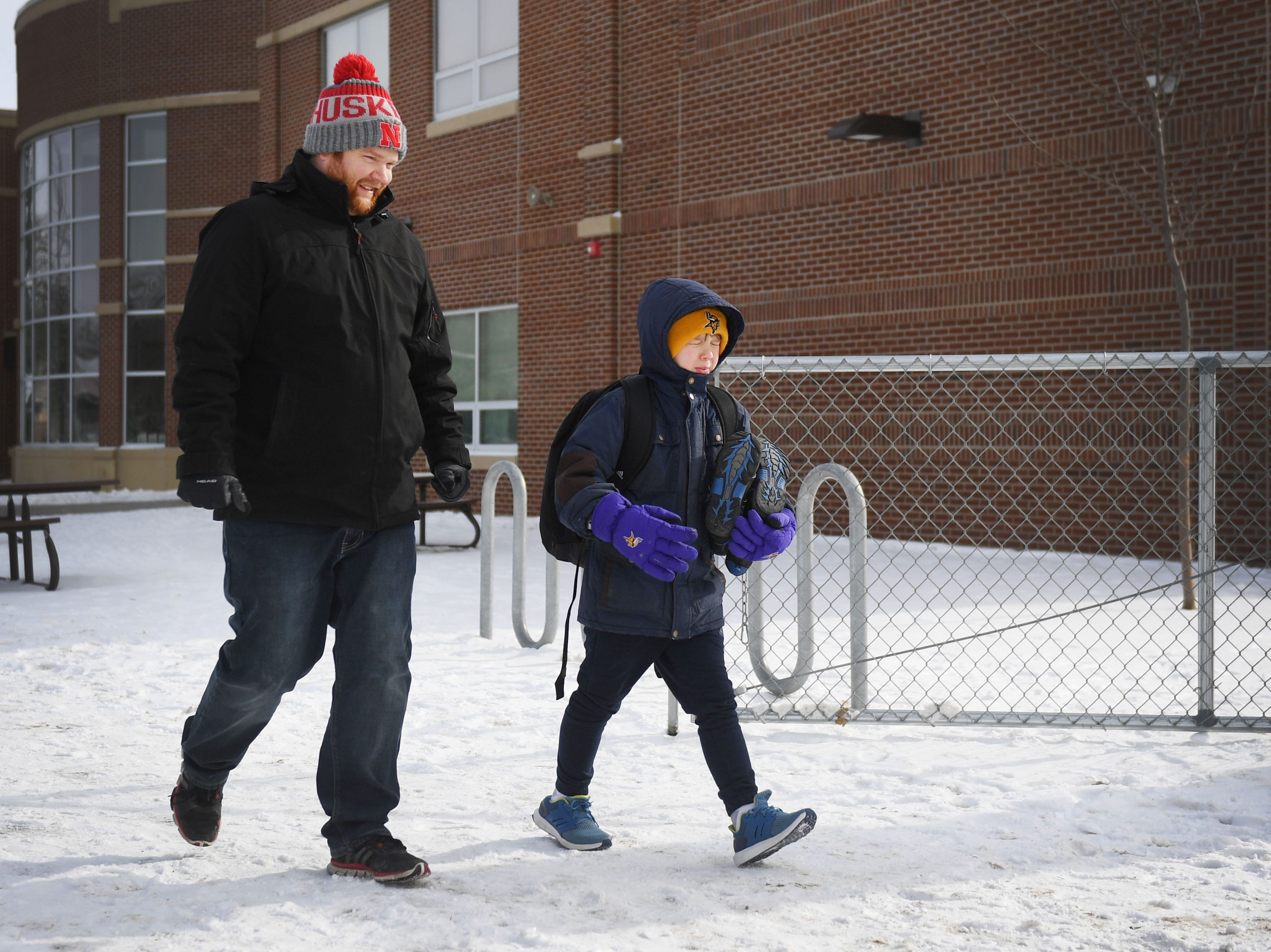 Joe Merriman picks up his nephew Ira Hanson at Susan B. Anthony Elementary School, Tuesday, Jan. 29, in Sioux Falls. Area schools had early dismissal Tuesday because of severe weather.