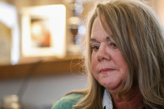 Kimberly Lightwine pauses as she talks about her son Austin.