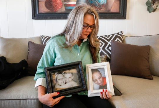 Kimberly Lightwine holds photographs of her son Austin.