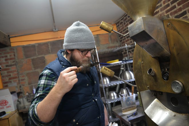 Staunton Coffee Company roaster and general manager Beau Lafon roasting coffee Thursday, Jan. 24, 2019.