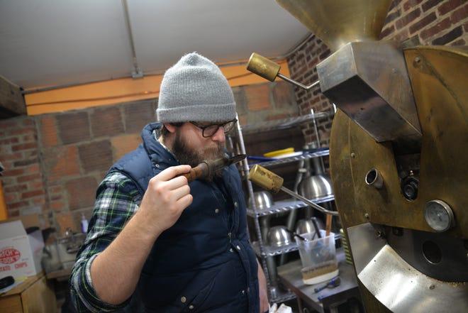 Staunton Coffee Company roaster and general manager Beau Lafon roasting coffee Thursday, Jan. 24, 2019.