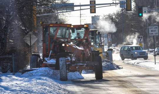 Crews clear snow from the sidewalks and shoulder along Ninth Avenue North as temperatures plummet Tuesday, Jan. 29, in St. Cloud.