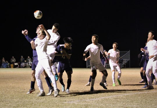 St. John Paul II's Tyler Lattner goes up between two Wakulla Christian players and flicks a header for the game-winning goal. St. John Paul II beat Wakulla Christian 2-0 during a District 1-1A boys soccer district quarterfinal on Jan. 28, 2019.