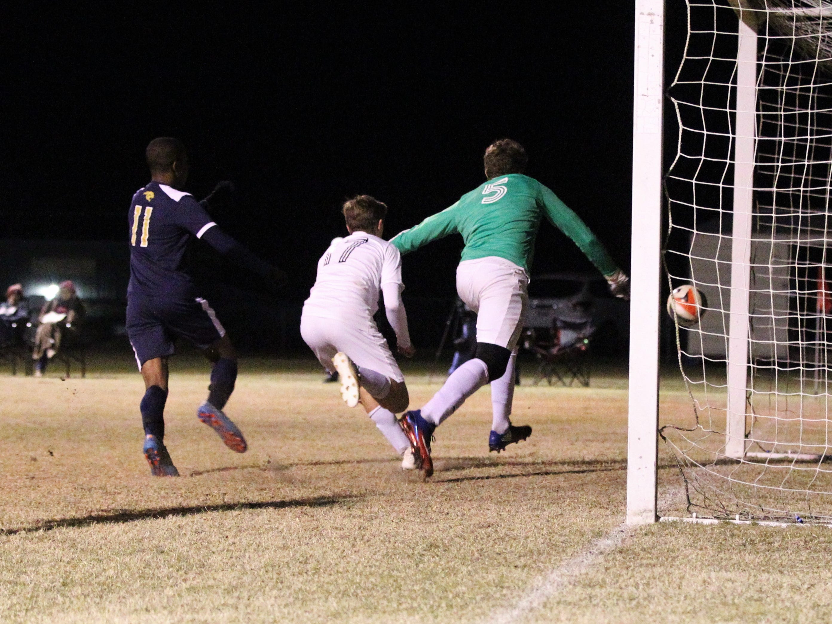 Wakulla Christian keeper Seth Dudley can only watch as a header from St. John Paul II's Tyler Lattner bounces in the box and slips inside the far post for the game-winning goal as SJP2 beat Wakulla Christian 2-0 during a District 1-1A boys soccer district quarterfinal on Jan. 28, 2019.