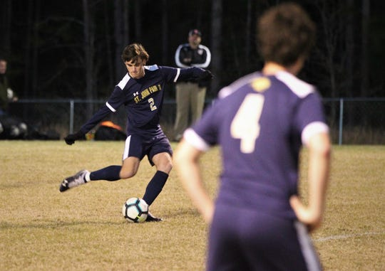 St. John Paul II senior Cooper Lake takes a free kick as SJP2 beat Wakulla Christian 2-0 during a District 1-1A boys soccer district quarterfinal on Jan. 28, 2019. Lake scored on a penalty kick for the Panthers' second goal.