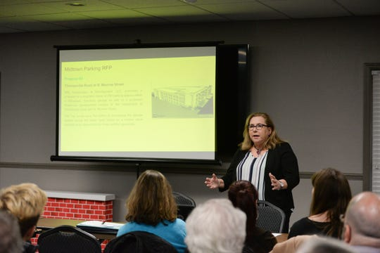 Director of Real Estate Management for the City of Tallahassee Judy Donahoe presents information on the Midtown parking request for proposals during a meeting at the Tallahassee Board of Realtors office to discuss the building of a parking structure in Midtown Monday, Jan. 28, 2019.