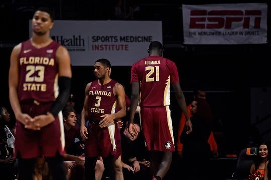 Jan 27, 2019; Coral Gables, FL, USA; Florida State Seminoles center Christ Koumadje (21) leaves the court after being ejected from the game for a flagrant 2 foul against the Miami Hurricanes during the second half at Watsco Center. Mandatory Credit: Jasen Vinlove-USA TODAY Sports