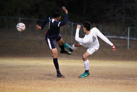 Wakulla Christian's Zeb Lewis one-times a bouncing ball for a shot that just missed being a goal, and St. John Paul II beat Wakulla Christian 2-0 during a District 1-1A boys soccer district quarterfinal on Jan. 28, 2019.