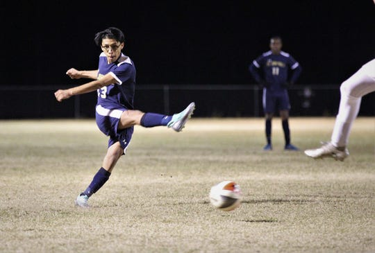 St. John Paul II's Fernando Huapilla rips a low shot that is saved as SJP2 beat Wakulla Christian 2-0 during a District 1-1A boys soccer district quarterfinal on Jan. 28, 2019.