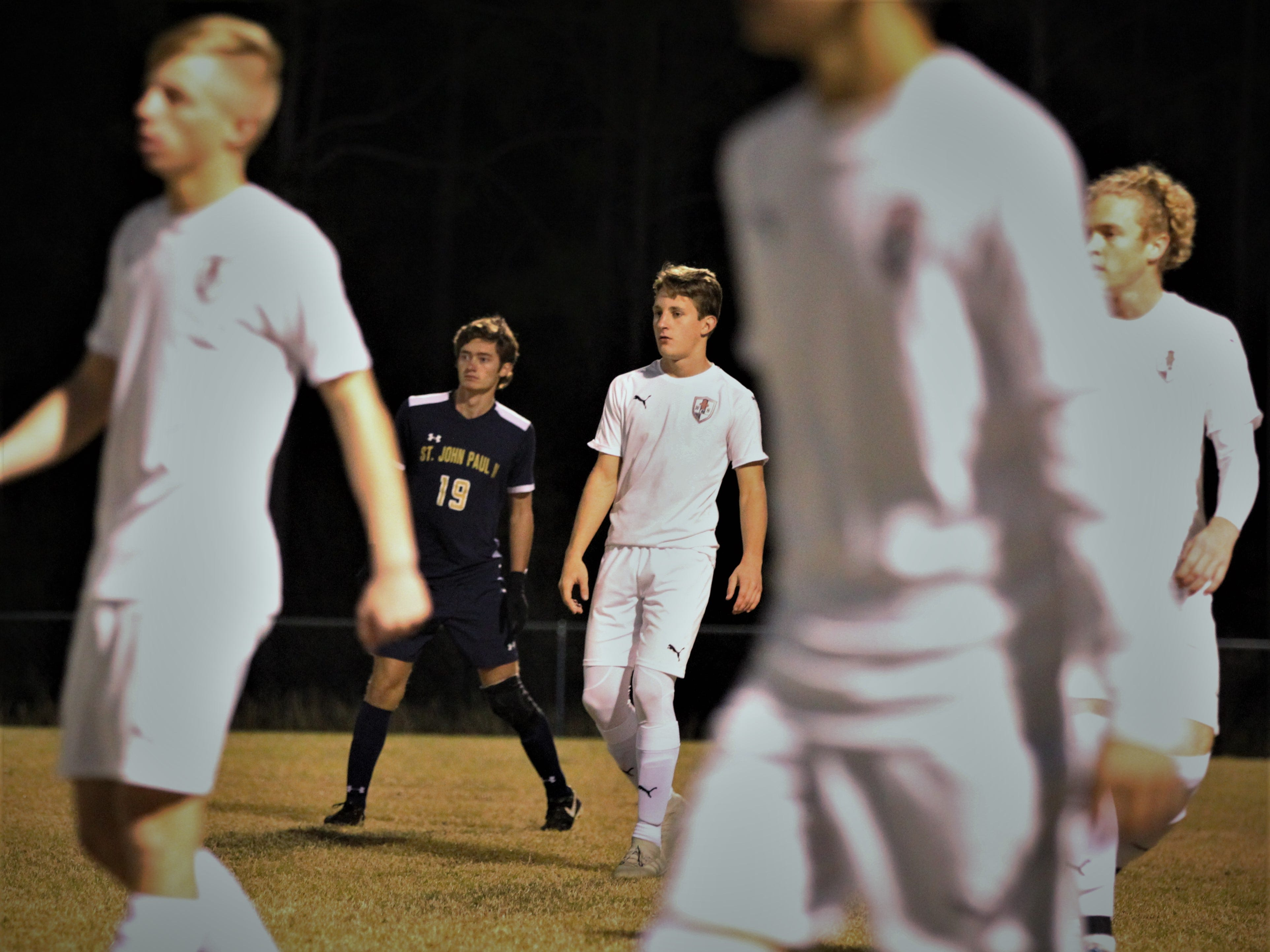 St. John Paul II senior Braidan O'Connor is covered up by four Wakulla Christian defenders as SJP2 beat Wakulla Christian 2-0 during a District 1-1A boys soccer district quarterfinal on Jan. 28, 2019.