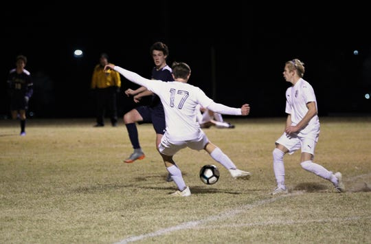 Wakulla Christian's Mason Odom takes a one-time shot off a pass, but the shot slips just wide of goal, and St. John Paul II beat Wakulla Christian 2-0 during a District 1-1A boys soccer district quarterfinal on Jan. 28, 2019.