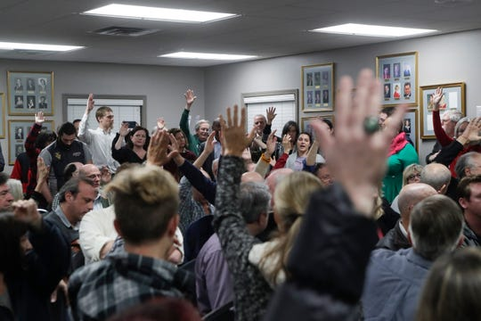 Carrie Litherland asks those who are opposed to the building of a parking structure in Midtown to raise their hands during a meeting at the Tallahassee Board of Realtors office to discuss the proposal in Midtown Monday, Jan. 28, 2019.